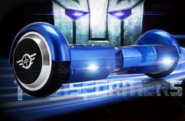2,015 Nouvelle Mini intelligente 2 roues auto équilibrage électrique mains roue libre scooter hoverboard skateboard électrique ? partir de fabricateur