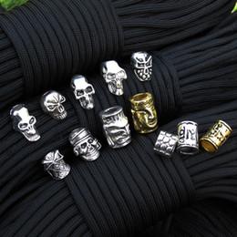 bouchon de perles de 9 mm Promotion Gros-10pec / lot Keychain Anneau Boucle DIY Chaîne en plein air paracord accessoires Pendentif Métal Crâne perles Pirate Camping