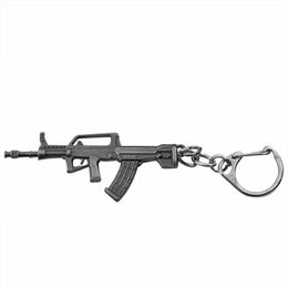 Wholesale Gun Metal Game - The game accessories through the fire line weapon, 95 submachine gun and metal model key chain personality 100 creative surprise