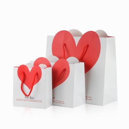 Wholesale gift ideas jewelry - Heart Boutique Shop Paper Bags Retail Gift Packages Color Choice Jewellery Clothes Carrying Bag with Cord Handle Creative Packaging Idea