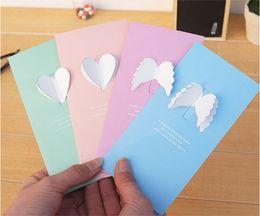 Tarjetas de felicitación tridimensionales online-Alas tridimensionales creativas Mini tarjeta de felicitación plegable Gracias de boda Mensaje Tarjeta de regalo cumpleaños Tarjeta de felicitación del día de San Valentín bendición