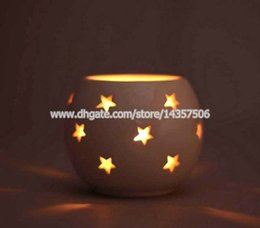 Wholesale Star Candle Holders - European Creative Porcelain Hollow Out Art Candle Holder Pierced Star Pattern Wedding Tea Light Holder for Home Bar Decoration