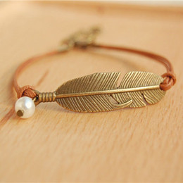 Wholesale Feather Metal - Simple Metal Feather Wristband Bracelets Tribal Simulated Pearl Brown Wax Cord Adjustable Link Leather Bracelet for Women nsl01