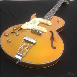 Guitares électriques à corps creux gauche en Ligne-Vente chaude or guitare électrique gaucher avec micros zèbre et corps creux