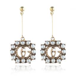 Canada Perles blanches Lettre Dangle Boucles D'oreilles Creuse Longue Boucles D'oreilles De Noce Bijoux De Mode Accessoires Accessoires Cadeaux Pour Femmes Offre