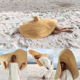 Sombrero de paja grande online-Moda Grande Sombrero de Sol de Playa Anti-UV Protección Solar Plegable Casquillo de la Paja Mujer Verano Big Sunhat Novedad Headwear