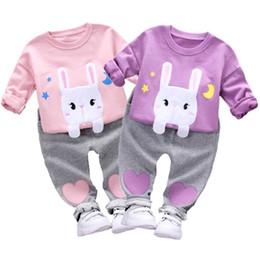 Manicotto lungo del coniglio del vestito online-Di buona qualità Moda Vestiti della neonata Set 2 pezzi Manica lunga Coniglio Stampa Pullover Top Amorosi Pantaloni cuore Set roupas infantis menina