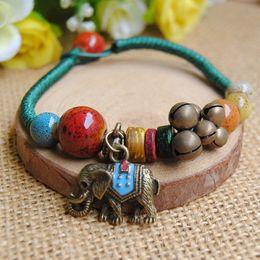 Keramik Armband Schmuck Großhandel Baby Elefant Messing Glocke Zubehör handgewebte Boutique Vintage Armband Großhandel von Fabrikanten