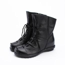 Botas de mujer de cuero genuino de estilo vintage Botines planos negros Zapatos de mujer de piel de vaca suave Botines con cremallera frontal Invierno desde fabricantes
