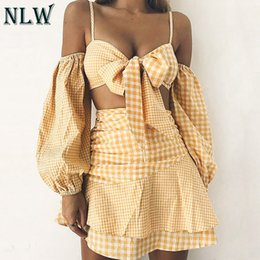 Tube de filles d'été en Ligne-NLW 2019 été femmes mode décontracté costume de plage sexy à carreaux Crop Tops et jupe à volants fille Bow Tube haut taille haute jupe ensemble