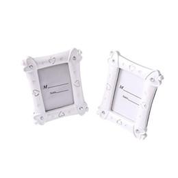 Tavolo per foto online-Portafoto in resina bianca con cuore in cristallo per foto e accessori per bomboniere