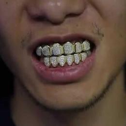 Зубы клыка онлайн-18 К Позолоченный Медный Хип-Хоп Iced Out Зубы Вампира Клык Grillz Стоматологическая Рот Грили Скобки Зубная Крышка Рок Рэппер Украшения для Косплей Партии