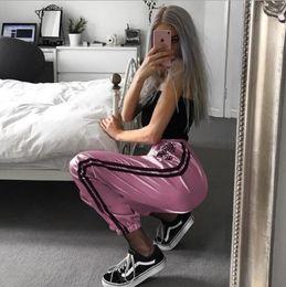 Europa harem pants moda online-2019 Europa primavera e autunno tigre ricamo femminile pantaloni rosa vita alta pantaloni harem casual moda nastri moda fascio pantaloni della tuta