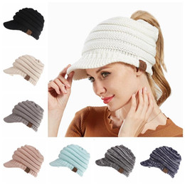 wholesale Winter CC Ponytail Hats 12 Colors Knitted Baseball Beanie Warm  Caps Crochet Hat Messy High Bun Cap Outdoor Beanies 50pcs 3bba35dda5bc