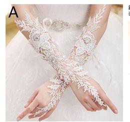 Vestido de novia de la novia nueva Guantes de encaje Perlas de clavos de perforación Vestido de novia Guantes largos desde fabricantes