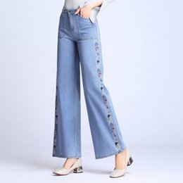 2020 вышитые факельные джинсы Free Shipping New 2019 Women's wide-leg Jeans Spring and autumn Fashion High Denim Pants Flares Embroidered Trousers дешево вышитые факельные джинсы