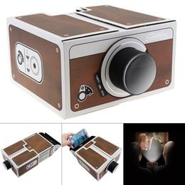 Proiettori telefonici online-DIY 3D Carta proiettore Consiglio Mini Smartphone luce del proiettore della novità regolabile Proiettore Cellulare Cinema portatile In A Box HMP_20Q