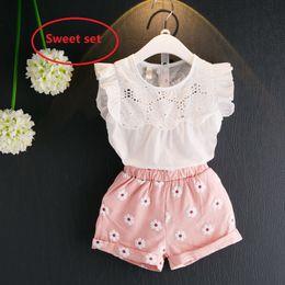 ropa de bebé de algodón blanco Rebajas Summer Sweet Baby Girl Clothes Set Camisa blanca de algodón Top manga de alboroto bordada + Daisy Shorts 2pcs / set 12M-6Y Hotsale