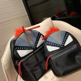 Zaino da donna maschio Il nuovo 2019 Little Monsters Zaino in tessuto di nylon Zaino per scuola Zaini di design Han Edition di grande capacità in stile caldo cheap designer fabric bags for women da sacchetti di tessuto designer per le donne fornitori
