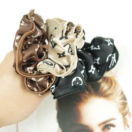cheer bows schwarz Rabatt Bedruckte Seidenstretch-Stirnbänder, siebenfarbige Kopftücher von Modedesignern
