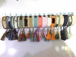 Il braccialetto materiale della corda di qualità superiore con le parole di cucito e il regalo famoso dei gioielli di marca della nappa liberano il trasporto PS6230 da bracciali infinty fornitori