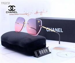 großhandel schöne sonnenbrille Rabatt Schöne Großhandelsdamen, die hd randlose Retuschegesichtssonnenbrille hd Harzobjektivsonnenbrille fahren, tragen Komfortgürtel mit Kastensonnenbrille