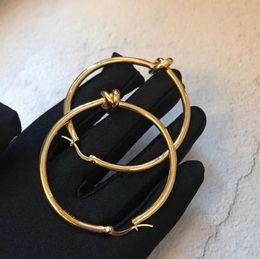 brincos de coração de ouro branco huggie Desconto Brincos de jóias de grife europeu KNOT grande acabamento em ouro amarelo círculo de cobre brincos mulher de luxo brincos de noivado de casamento