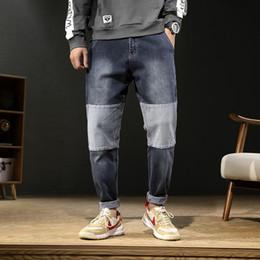 pantalones del remiendo del diseño de la manera Rebajas Calidad Japón Estilo Hombres Jeans Moda Patchwork Diseño Casual Denim Harem Pants Mid Waist All Match Jeans sueltos Pantalones hombres 42