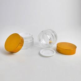 O cosmético de vidro de creme vazio do frasco de 200 x de 20g compo a tampa de prata do ouro do potenciômetro recarregável da emulsão dos recipientes 2 / 3OZ da amostra supplier gold glass jar lid de Fornecedores de tampa do frasco de vidro dourado