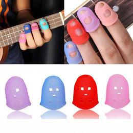 2020 dicas de guitarra 4 Pcs dedo ponta Protector Silicone String Guitar Finger Guard contra a imprensa Dedo Balada Guitarra Acessórios desconto dicas de guitarra