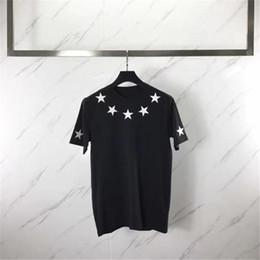 2019 pantalones cortos Primera marca famosa camiseta para hombre Ropa Hombres Mujeres de la manga corta de cinco puntas de la estrella de impresión Flock Tees rebajas pantalones cortos
