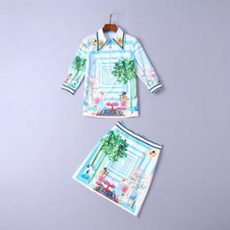 Ropa de invierno para mujeres europeas y americanas 2018 Nueva solapa de cuentas de uñas Camisa de manga tres cuartos + Falda estampada desde fabricantes