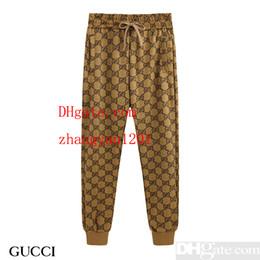 Mens 2019 marca de ropa de color amarillo carta bordado ocasional de encaje pantalones deportivos hombres ropa de verano sección delgada pantalones casuales ACF-5 desde fabricantes
