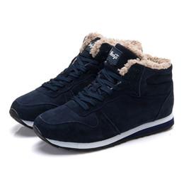 Botas de invierno ata hasta la piel online-Botas de mujer Botas de invierno cálido Botas de nieve para mujer Flock Zapatos de mujer con cordones Botas de tobillo de piel Zapatos de nieve de moda más el tamaño 46