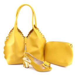 Ultime scarpe in pelle morbida gialla con borsa imposta italiano grado superiore con grande borsa Vendita calda all'ingrosso scarpe africane e borsa da borse morbide fornitori