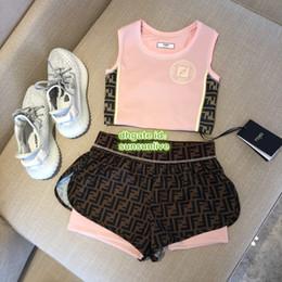 Shirts tecidos de calças on-line-Mulheres Tecido De Fitness Malha Duas Peças Calças Tops Colete Com Carta de Impressão T-Shirt Tee + Jogging Cintura Alta Magro Shorts Camisa Set