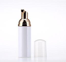 Botella de burbujas online-Botellas de espuma de viaje de 50 ml Botellas de espuma de plástico vacías con bomba de oro Jabón de lavado a mano Dispensador de crema de mousse Botella burbujeante Sin BPA
