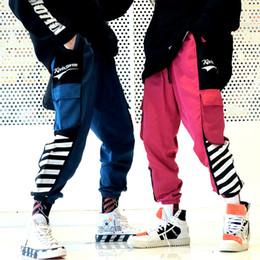 Pantalones de carga urbana online-Hip Hop bolsillos pantalones Harem Joggers Streetwear hombres 2019 Harajuku Casual pantalones holgados urbanos pantalones de chándal de moda