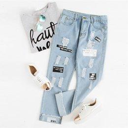 2020 nuevos jeans modernos Jeans para mujer pantalones de las mujeres de impresión de letras Ripped Jeans Button nuevo de la manera del resorte de la mosca mediados de cintura mujeres modernas Pantalones Casual bolsillo de los tejanos rebajas nuevos jeans modernos