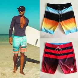 Elástico moda shorts homem on-line-Homens Calções de Praia Impresso À Prova D 'Água Quick Dry Surf Shorts Marca Cintura Elástica Solta Swimwear Nova Moda Shorts Casuais 05