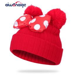 Sombrero de punto para niños online-2019 Niños Bow Knot Ball Knit Cap Cute Boy Girl Sombrero de invierno con sombrero de oreja de dibujos animados Polka Dot al aire libre niños cálidos Innocent Cap