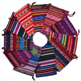pequeñas bolsas de regalos de tela Rebajas Estilo étnico tribal Rayas Tela de algodón Bolsa pequeña de joyería Bolsa de almacenamiento Cordón Bundle Boca Bolsa de regalo