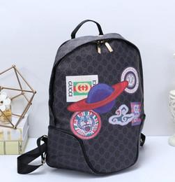 a6de5d5b0884 2019 змеиный рюкзак Горячая распродажа тигровая голова змеи модные сумки  черные бежевые женщины мужчины рюкзак стиль