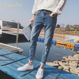 2019 jeans déchirés hommes coréens Ripped Hole jeans été été 2019 coréen pieds pieds pantalons en denim hombre Slim jeans effet jet d'encre minces promotion jeans déchirés hommes coréens