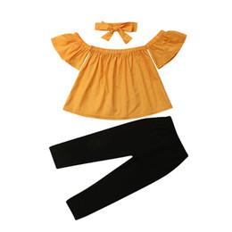 2019 Mode Enfants Fille Vêtements D été épaule Coton Jaune Tops + Pantalon  Noir + Bandeau Tenue Enfants Vêtements Set 2-7T promotion ensemble jaune  haut ... 8f3b160cb