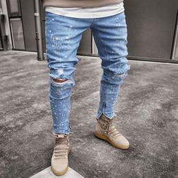 Furos claros on-line-Luz Azul Spark Designer Mens Jeans Primavera Outono Joelho Buracos Zipper Hiphop Calças Pantalones