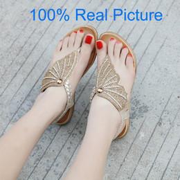 Sandales d'été en gros papillon aile femmes T-sangle tongs Thong Sandales Designer bande élastique strass Wedges sandale pour les femmes ? partir de fabricateur