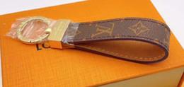 2019 llavero de la pata de los perros Diseñador de lujo hecho a mano de cuero PU llavero de coches Mujeres del encanto del bolso colgante llavero Accesorios con caja de regalo