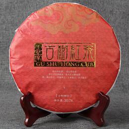 Venta al por mayor Yunnan té negro Fengqing árbol antiguo té negro hoja grande árbol antiguo Sunning 357 g Cake dianhong desde fabricantes