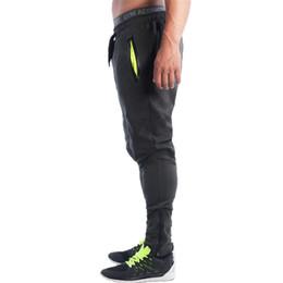 Canada Pantalons de fitness en gros-hommes Pantalons de survêtement Hommes Esthétique de gymnastique Pan Porter des vêtements de sport pour les coureurs Gris Vêtements Pantalon de survêtement mince Britches cheap sports wear clothing wholesale Offre